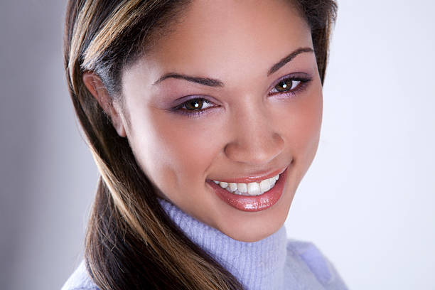mixed race woman with a beautiful smile stock photo