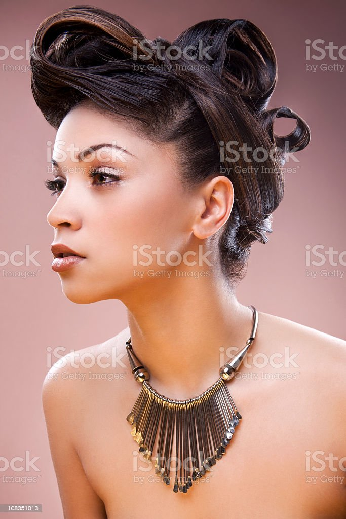 mixed race woman with updo stock photo