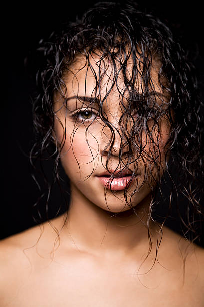 Mixed race woman with wet curly hair  wet hair stock pictures, royalty-free photos & images