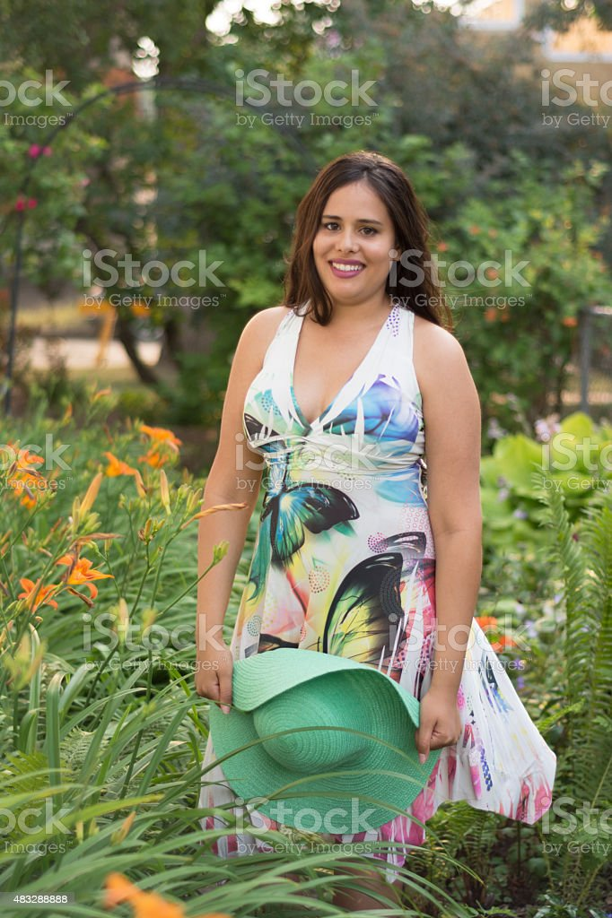 Mixed race young woman laughing in urban summer garden. stock photo