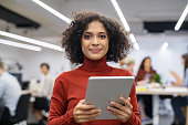 istock Mixed race young woman using digital tablet 1244518838