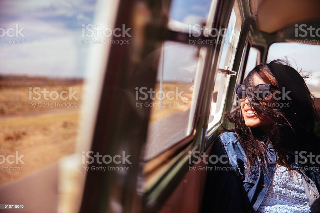 Mixed Raced Hipster Woman Smiling in Retro Van Road trip stock photo