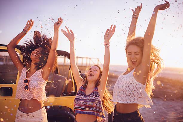 mixed racial group dancing on a beach with confetti - street dance bildbanksfoton och bilder