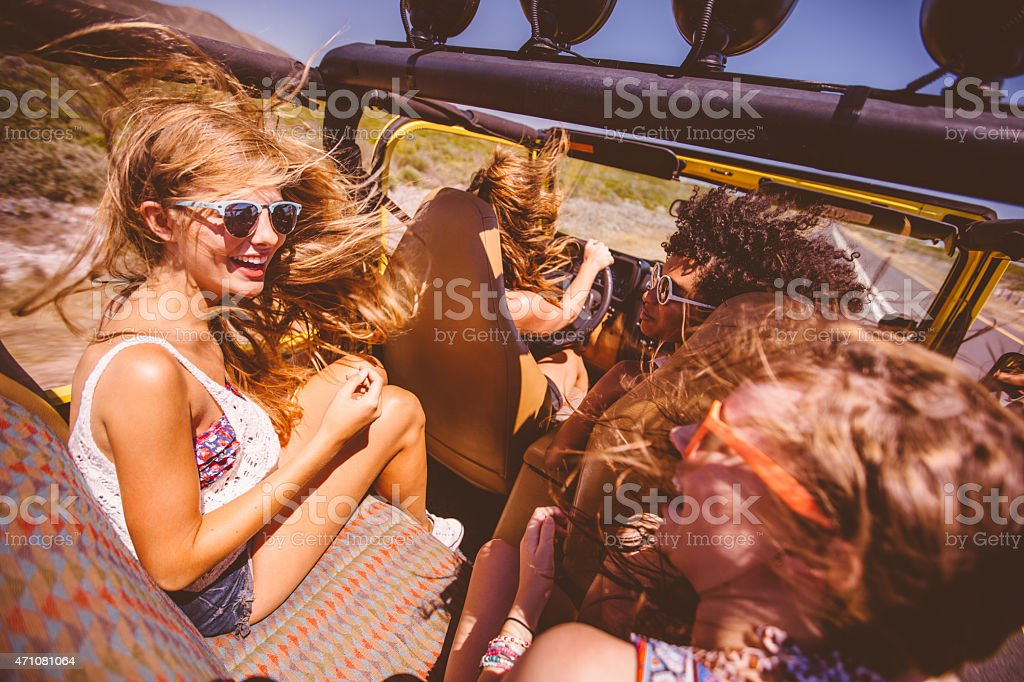 Mixed racial group of girl friends on a road trip stock photo