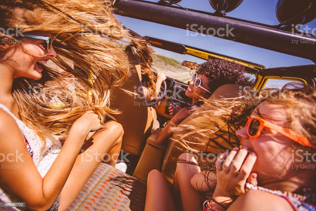 Mixed racial group of teen on road trip to beach stock photo