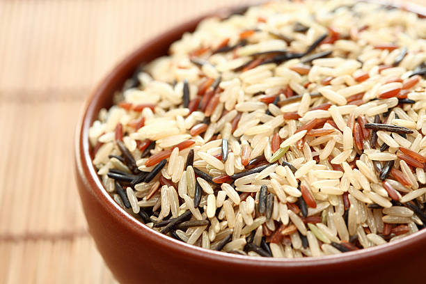 Mixed rice in bowl Mixed rice in a bowl. Close-up. basmati rice stock pictures, royalty-free photos & images