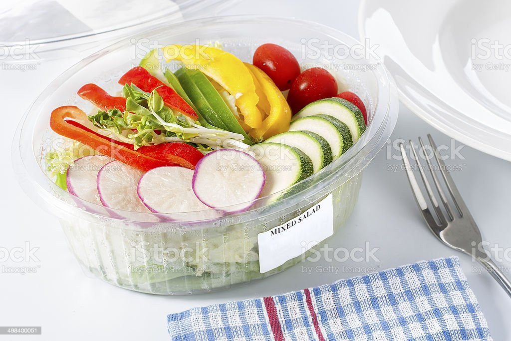 Mixed salad in a plastic box. stock photo