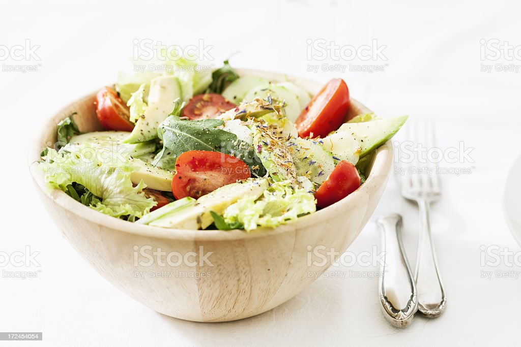 mixed salad in a wooden bowl royalty-free stock photo