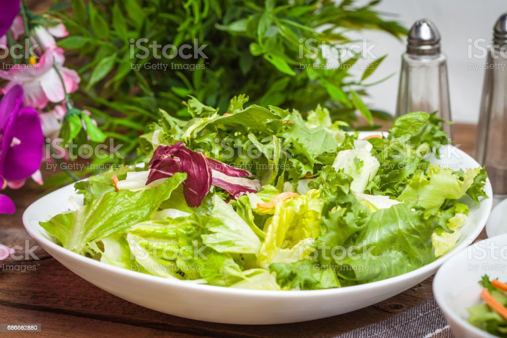 Mixed salad in white bowl. royalty-free stock photo