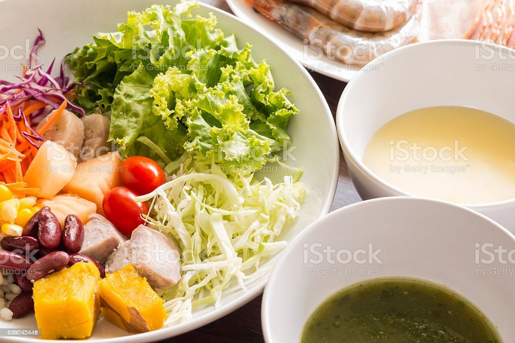Mixed salad with tomatoes, corn, carrots, cantaloupe, red beans, stock photo