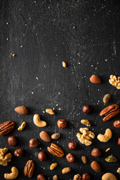 Mixed Salted Nuts on Black stock photo