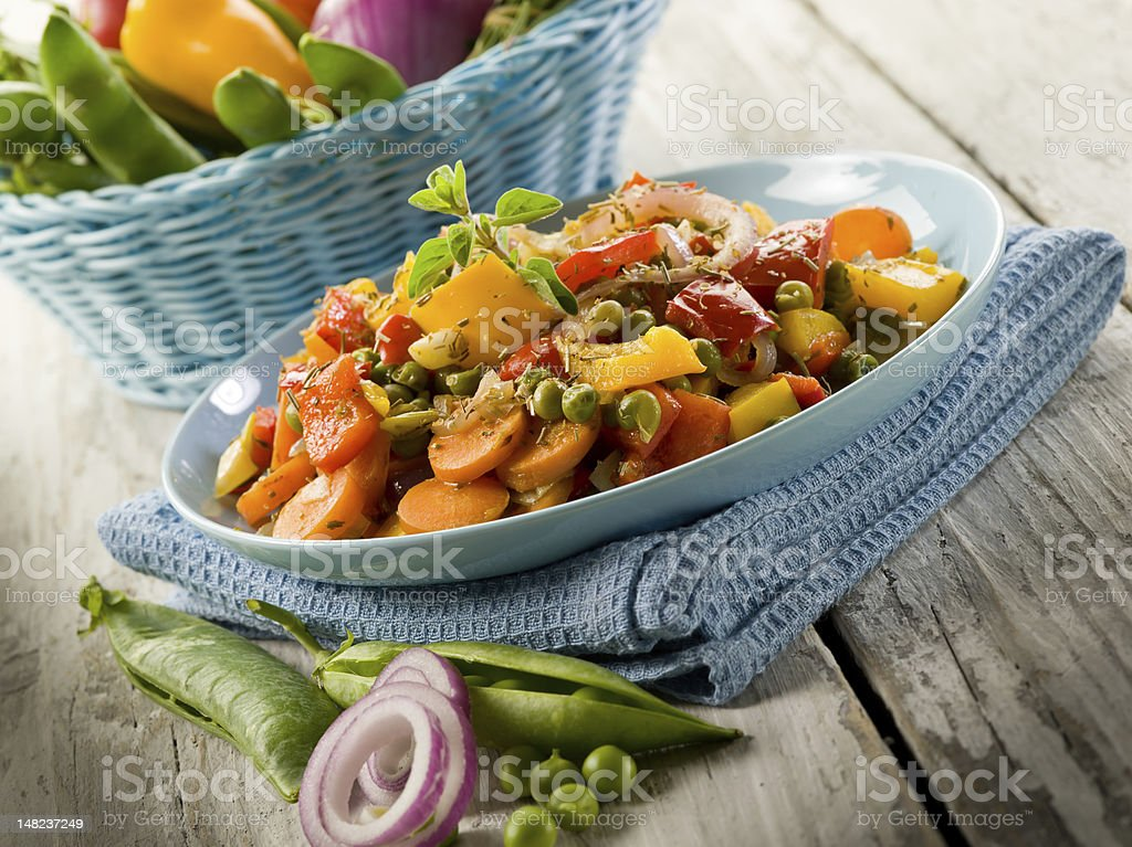 mixed sauteed vegetables mixed sauteed vegetables on dish over wood background Bean Stock Photo