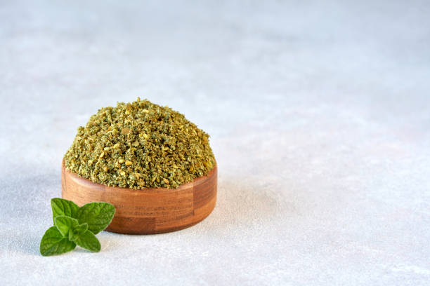 Mixed spice zaatar or zatar in wooden bowl on stone background Dried Food, Middle East, Food, Spices, Arabic cuisine zaatar spice stock pictures, royalty-free photos & images