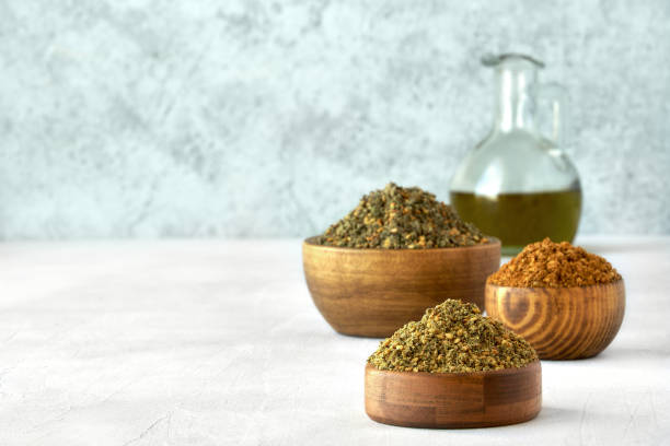 Mixed spice zaatar or zatar in wooden bowls, Various type of zaatar blend. Close up with copy space Dried Food, East, Food, Spice zaatar spice stock pictures, royalty-free photos & images