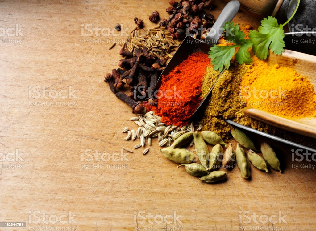 Mixed Spices on a Chopping Board royalty-free stock photo