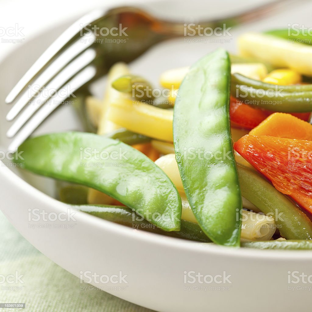 Mixed steamed vegetables in a bowl stock photo