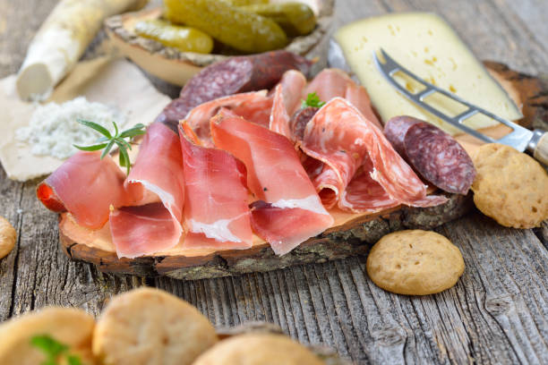 Mixed Tyrolean snack South Tyrolean snack with bacon, salami, red wine cheese, herb ham, fresh horseradish and local crunchy rye bread trentino alto adige stock pictures, royalty-free photos & images