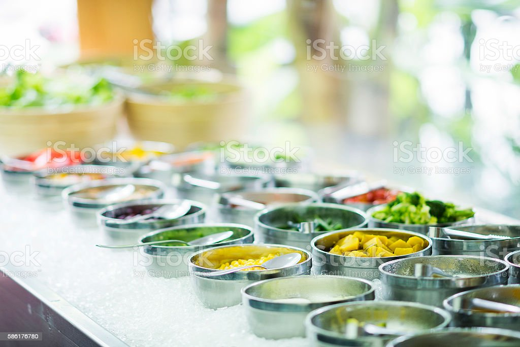 mixed vegetable ingredients in salad bar display stock photo