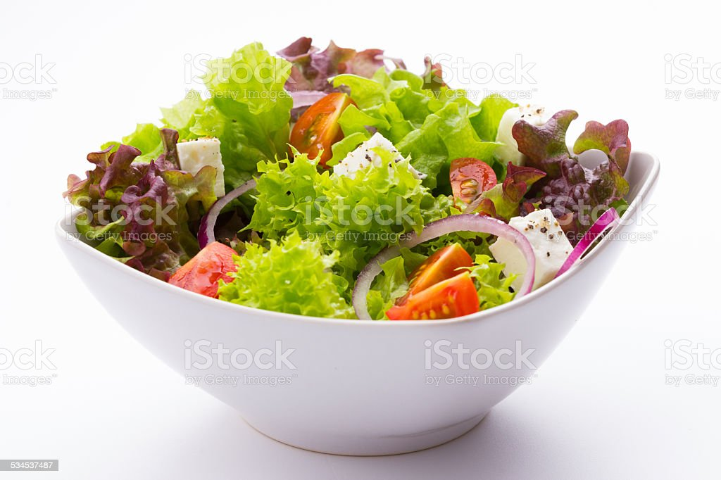 mixed vegetable salad with tomatoes and feta cheese stock photo