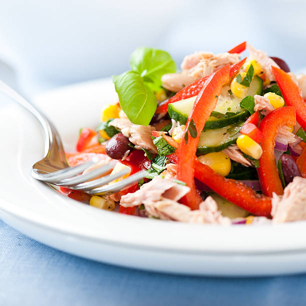 Mixed vegetable salad with tuna stock photo