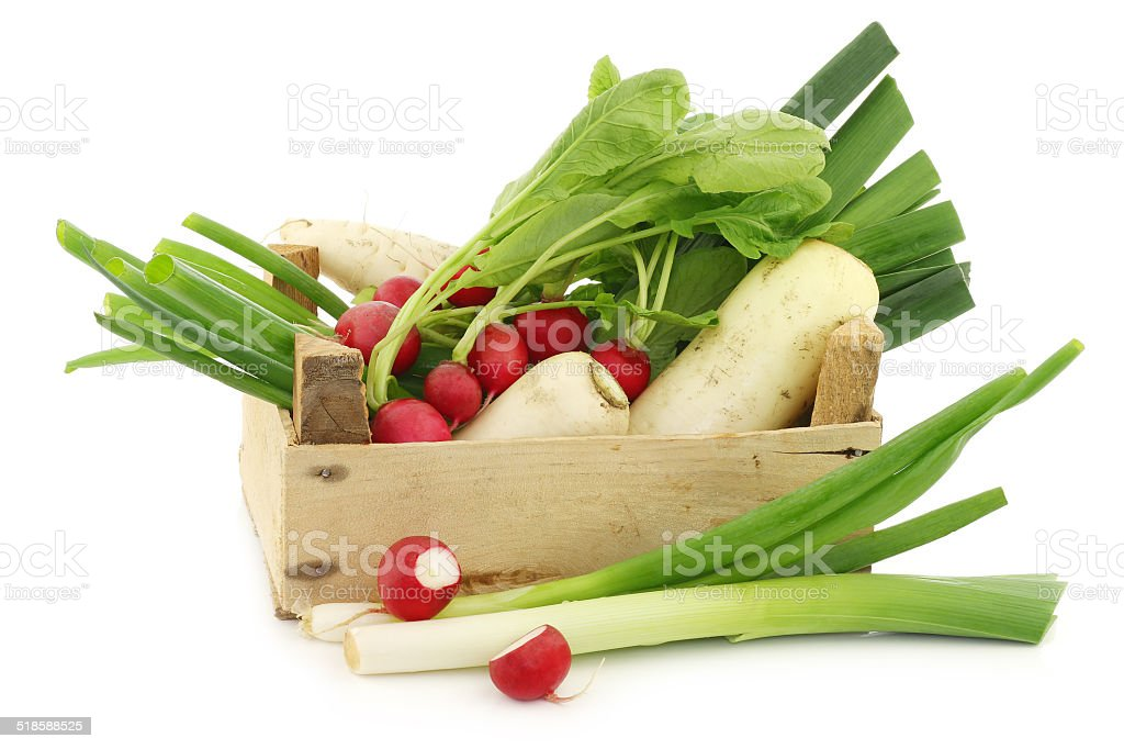 mixed vegetables in a wooden crate stock photo