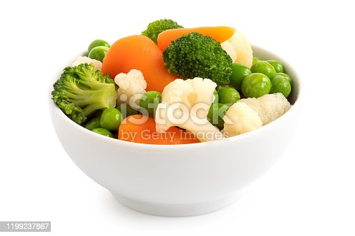 Mixed vegetables in white ceramic bowl isolated on white.
