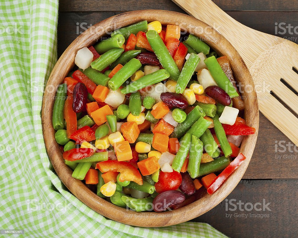 mixed vegetables in wooden bowl stock photo