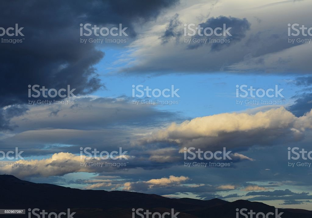 Evening landscape with a mixed array of cloud types.