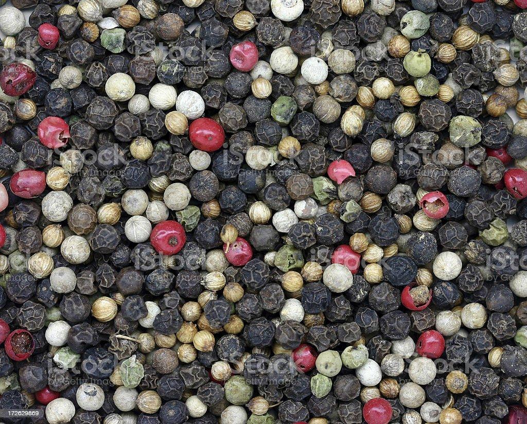mixed whole peppercorns stock photo