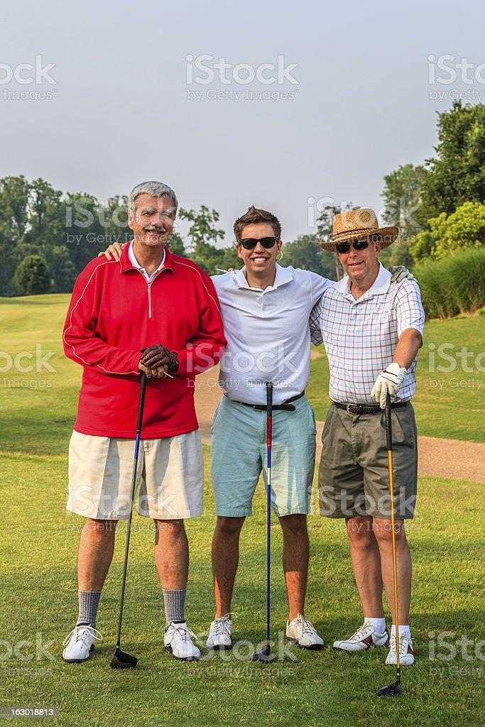 MIxed-Age Men's Golf Threesome stock photo