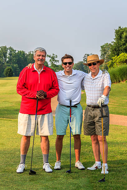 mixed-age men's golf threesome - carolinemaryan stock pictures, royalty-free photos & images
