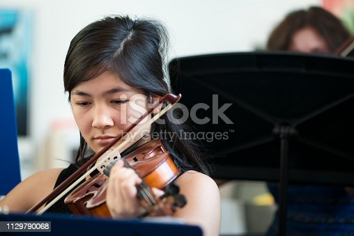 Multi-generation and multi-ethnic violinists performing in Vancouver, British Columbia, Canada