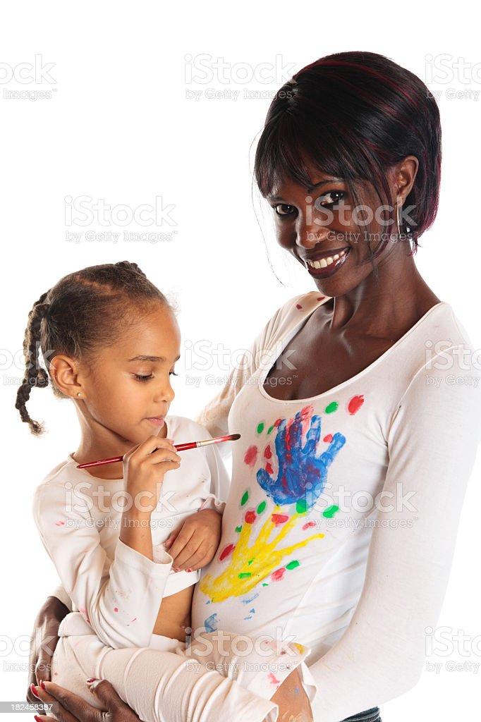 mixed-race family painting royalty-free stock photo