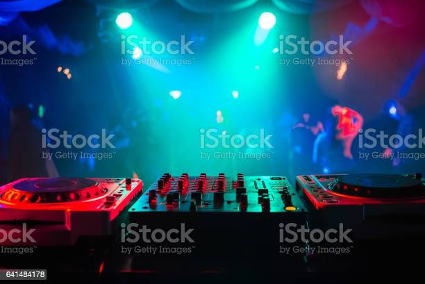 Mixer and a dj booth in the nightclub at a party with a diffuse picture id641484178?b=1&k=6&m=641484178&s=612x612&h=nrixk10gnfayoecndiezh2 h m3jnye6ogisqy7n544=