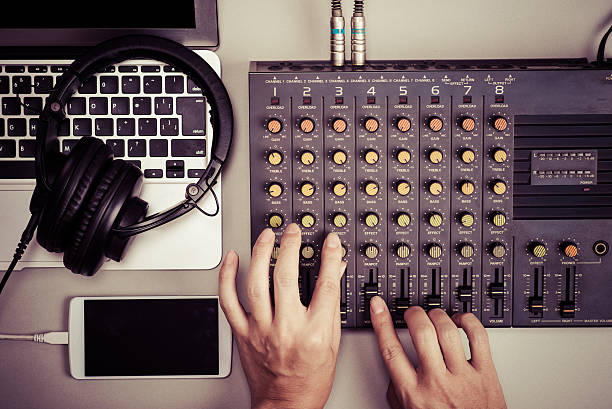 Mixer, laptop and smartphone Mixer, laptop and smartphone electronic music stock pictures, royalty-free photos & images