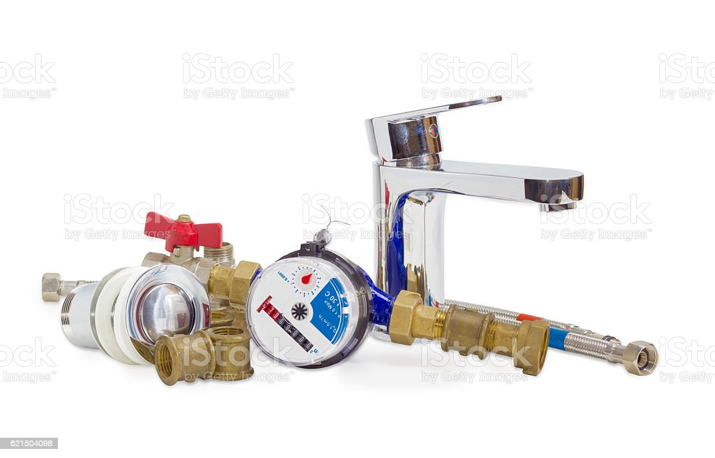 Mixer tap, water meter and some plumbing components stock photo