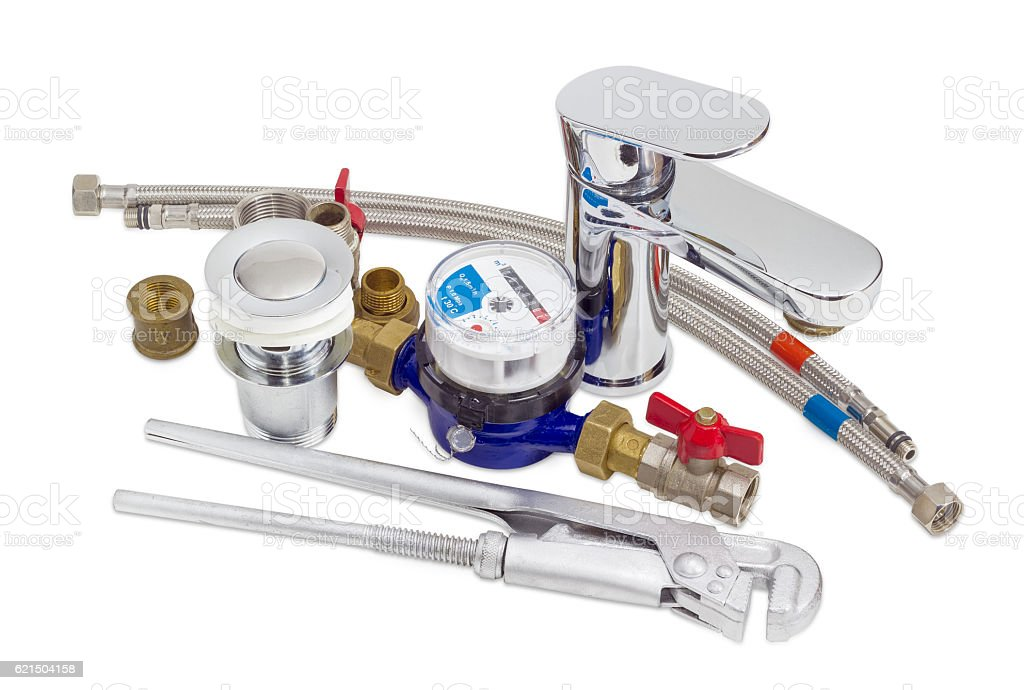 Mixer tap, water meter, plumber wrench and some plumbing compone stock photo