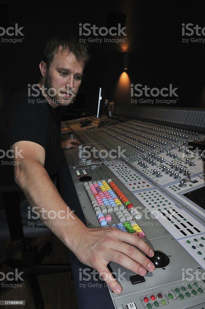 mixer working with the mixing console in sound studio royalty-free stock photo