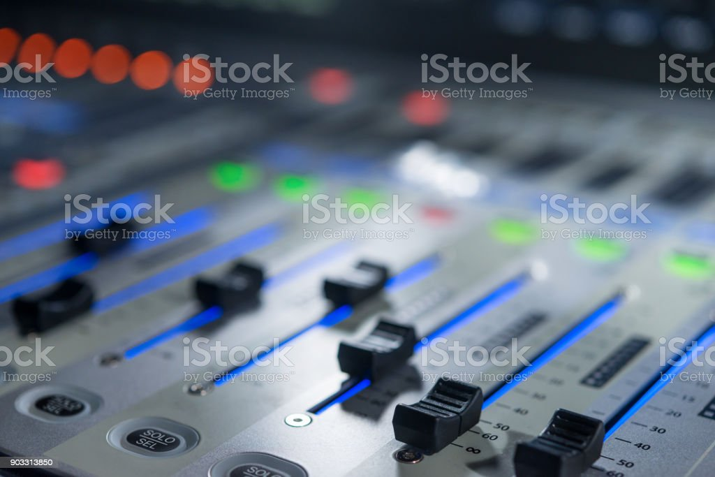 Mixers on the control panel on TV stock photo