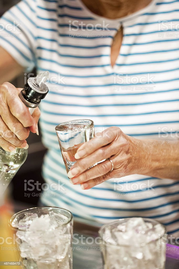 Mixing an alcoholic drink at a party royalty-free stock photo