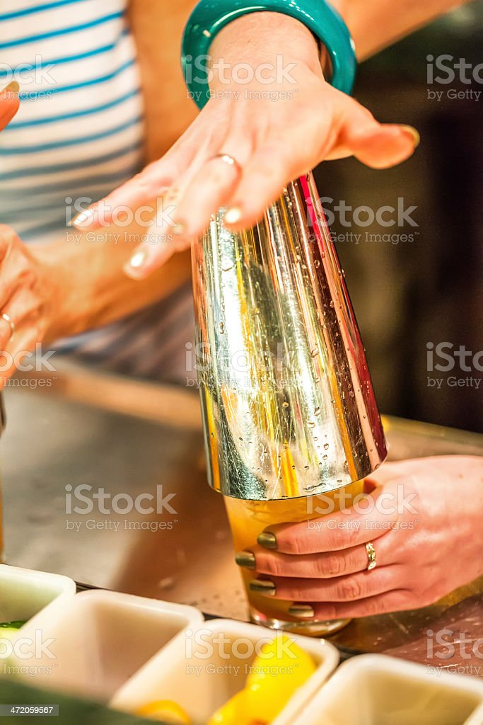 Mixing an alcoholic drink with a shaker New year's eve royalty-free stock photo