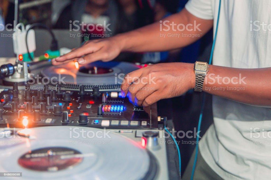 DJ mixing beats at party stock photo