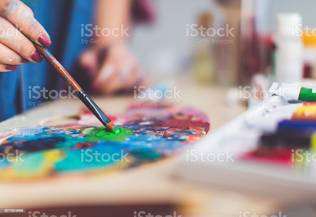 Mixing colour for new painting stock photo