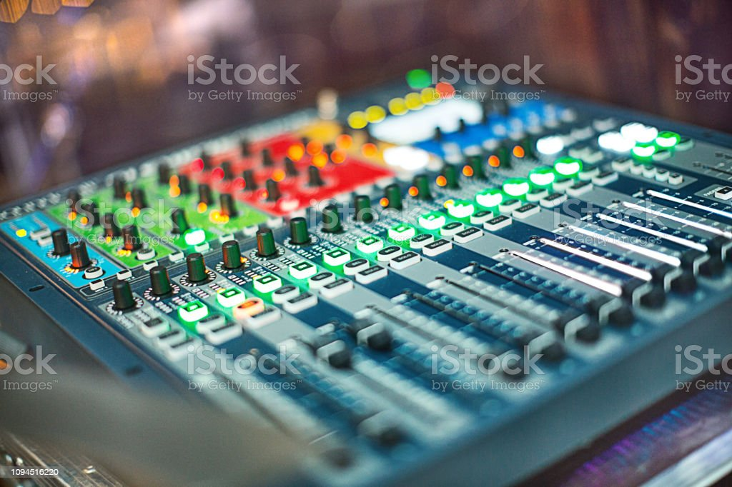 Mixing console at night club.