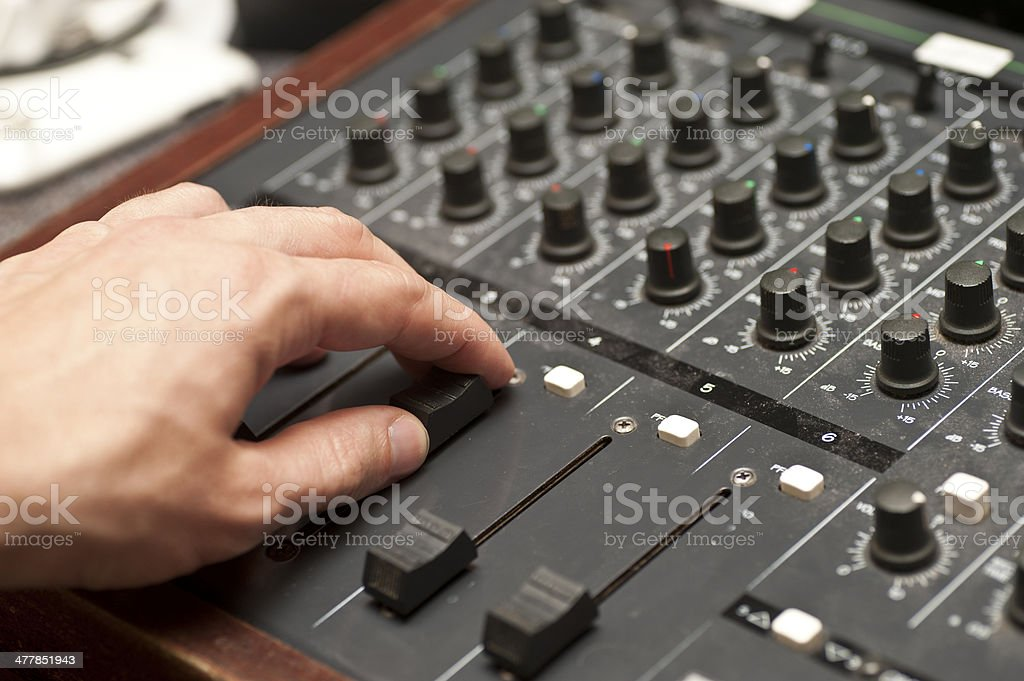 mixing desk with hand royalty-free stock photo