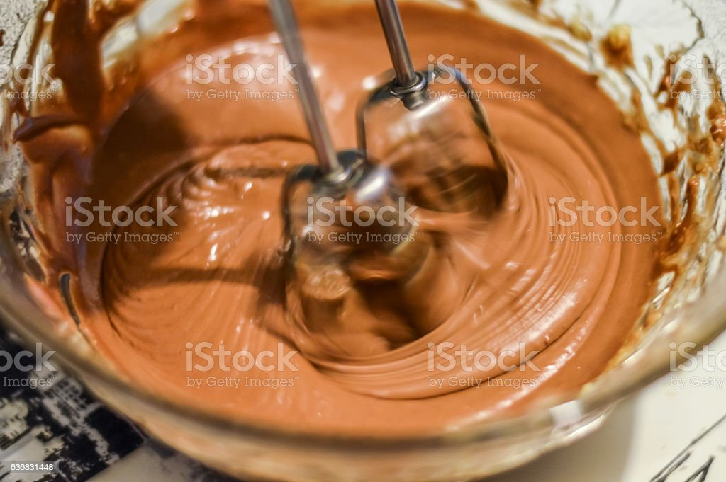 mixing ingredients with electric mixer to make cookies stock photo