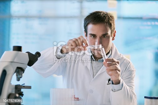 Cropped shot of a handsome young male scientist checking samples in his lab