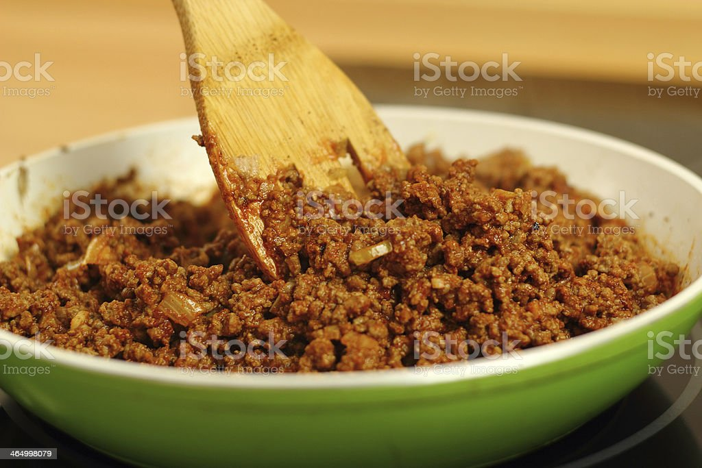 Mixing minced beef with spices, chilli sauce, onion and garlic. stock photo
