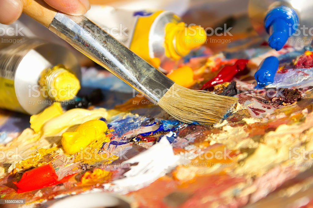 mixing oil paints with a brush royalty-free stock photo