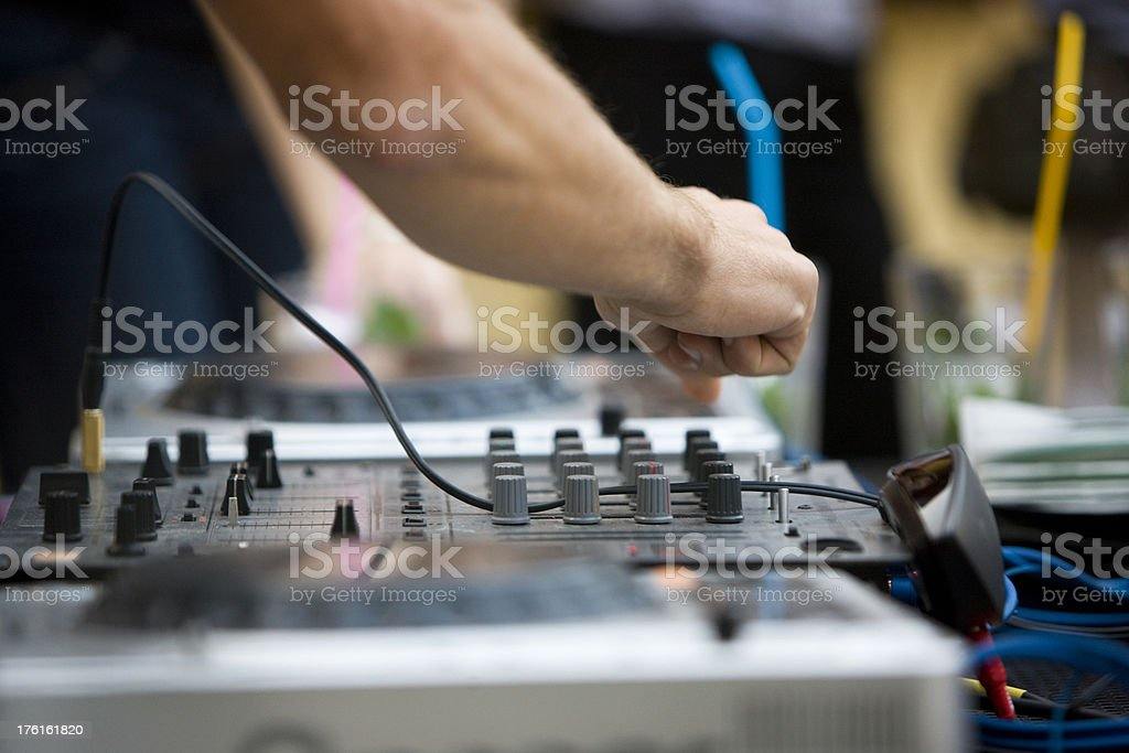 DJ mixing royalty-free stock photo